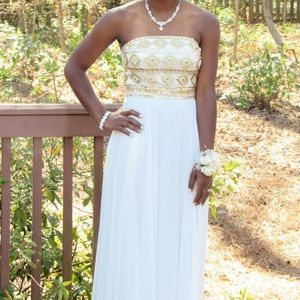 Beautiful gold beaded off white strapless dress.